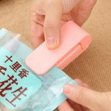 Portable Mini Plastic Bag Sealing Machine Laminating Machine Household Hand Pressure Heat Sealing Machine (Pink)