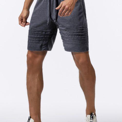 Mens Pocket Elastic Waist Solid Color Drawstring Loose Shorts Sport Activewear Shorts